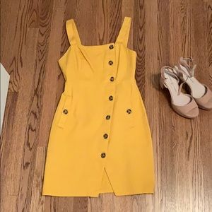 Yellow buttoned dress
